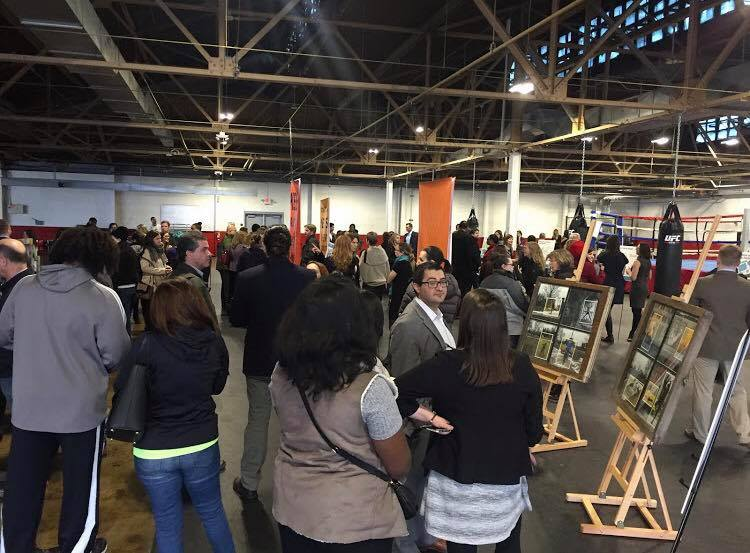 A crowd gathers at the Downtown Boxing Gym for Challenge Detroit's presentation